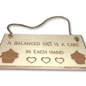 A Balanced Diet Is A Cake In Each Hand – Engraved wooden wall plaque/sign
