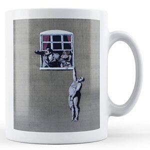 Banksy – Man Hanging From Window – Printed Mug