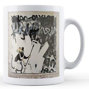 Banksy Rat Painting Over Graffiti – Printed Mug